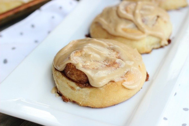 Our caramel cinnamon rolls come together in 90 minutes! Soft, cinnamon rolls covered in decadent caramel frosting. Easy to make and a definite crowd pleaser!