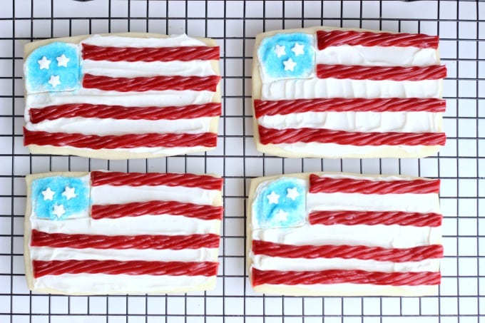 Theseflag sugar cookies are so easy to make with rectangle cookies and red licorice! Planning a BBQ for Memorial Day or the 4th of July? Don't forget a sugar cookies station for the kids!