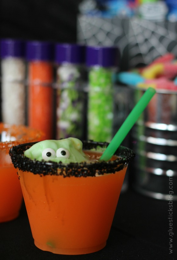 This little green monster Halloween punch is a show stopper! Sugar rimmed cups, a sherbet monster coming out of the punch cup, what more could you ask for?