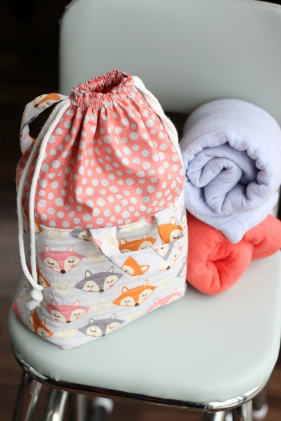 This cute fabric basket with an easy close drawstring can be used for things like toys, a mini diaper bag and more. It's a great baby shower gift!