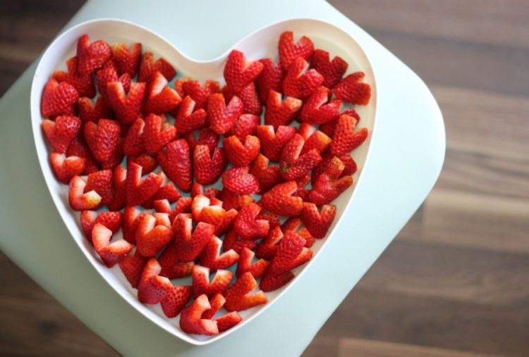 A platter of heart strawberries is a healthy and sweet Valentine's day treat! Perfect for class parties, preschool, or school lunches!