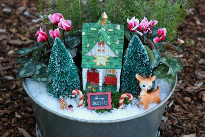 a beautiful christmas fairy garden to brighten your porch or home this holiday season get
