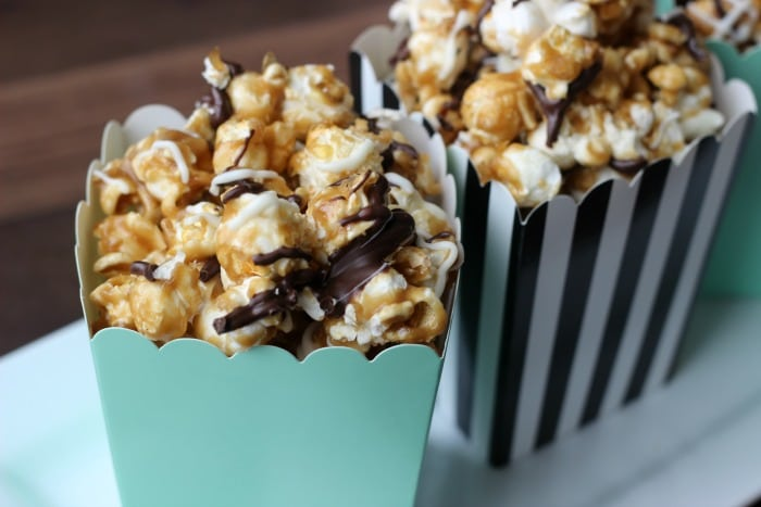 Homemade caramel corn drizzled in white and dark chocolate. This black and white caramel corn is easy to make and incredibly addicting!