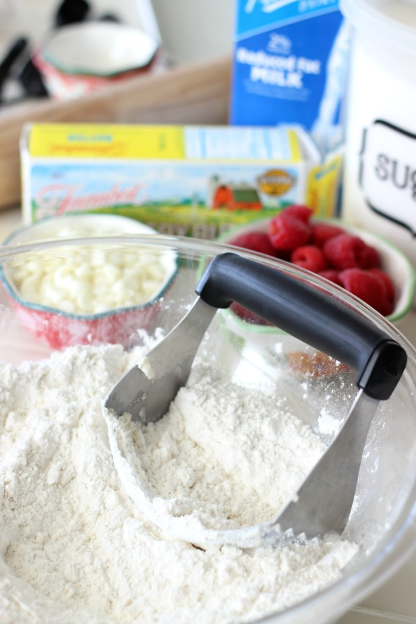 pastry cutter in a bowl of flour