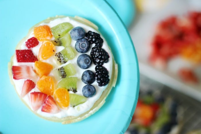 A delicious waffle bar that is as colorful as the rainbow! Fresh fruit, cream, and waffles combine for the perfect St. Patrick's Day breakfast (or dinner!) that the whole family will love.