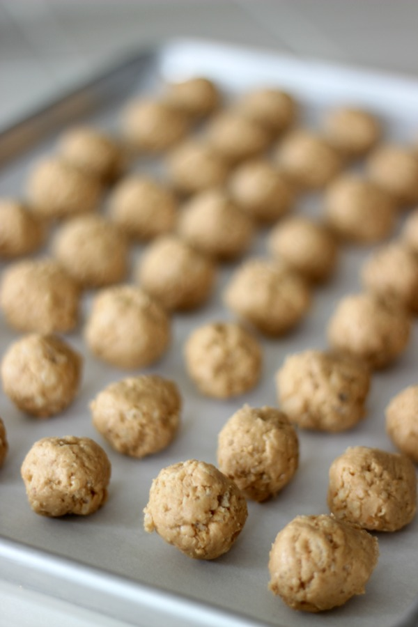 Crunchy peanut butter, rice crispies cereal, and white chocolate combine to create a decadent peanut butter truffle. Make a batch for Valentine's Day!