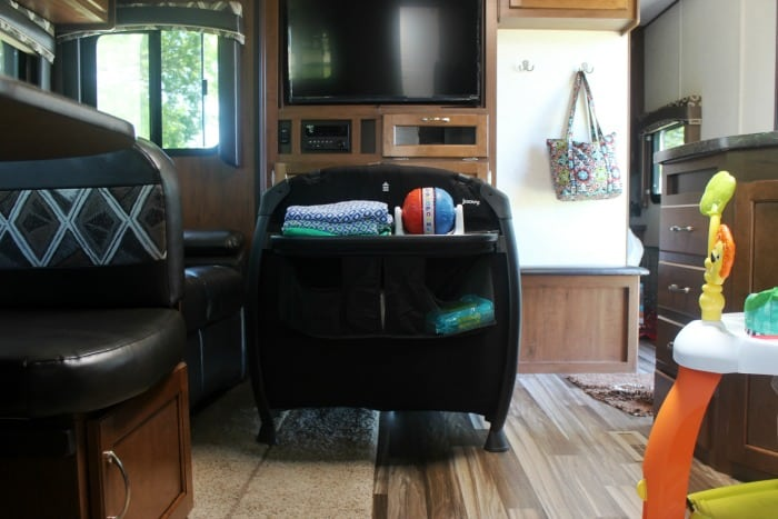 The perfect RV travel nursery for baby! It is compact, easy to fold and store, comes with a diaper station, bassinet insert, and lots of storage!  A great option for a summer on the road.