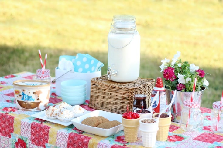 ice cream cookie sundae party set up on picnic table