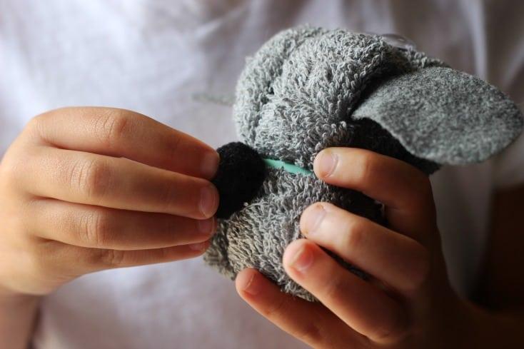 adding pom pom tail to puppy wash cloth