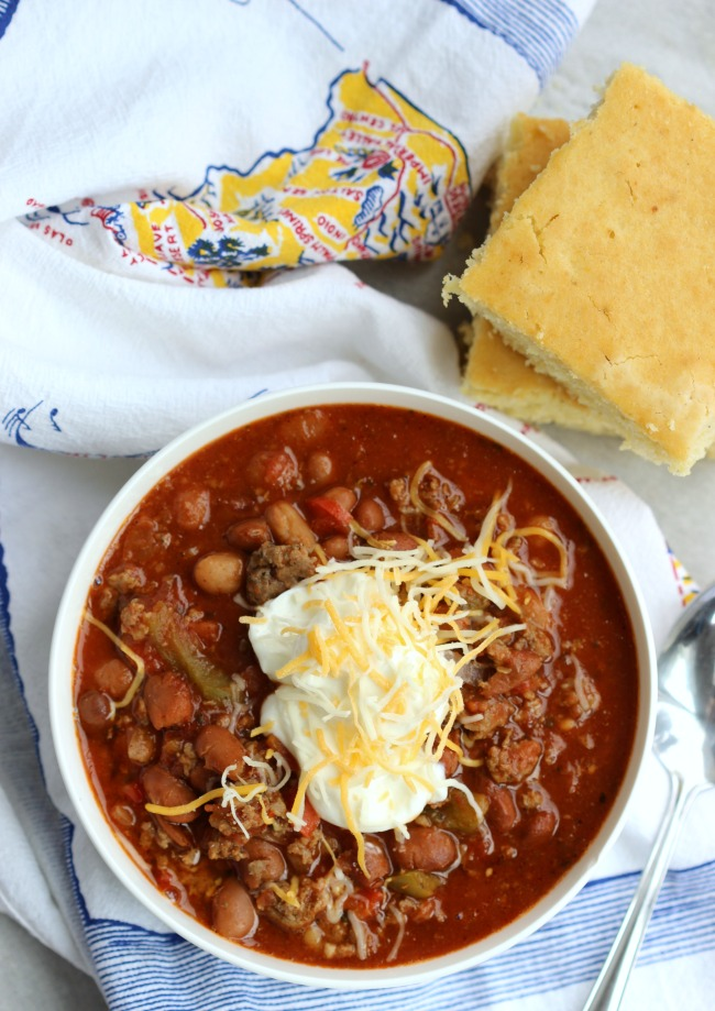 This delicious sausage and turkey chili recipe comes together quickly and simmers in the slow cooker until dinnertime! Tons of flavor without a lot of heat so it's kid-friendly too!