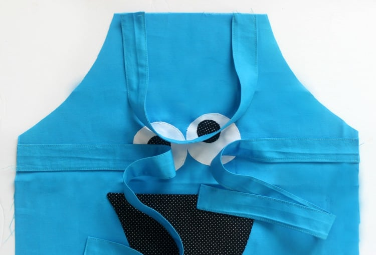 cookie monster apron with neck ties and straps. Ready to be pinned and finished.