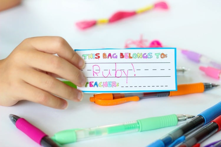 Make a pom pom key chain to accessorize your back pack this year! With a printable name tag to color, it is a fun and personalized way to label your bag!