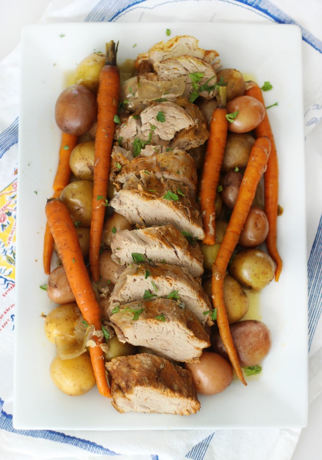 A delicious marinatedpork tenderloin with root vegetables that takes 10 minutes to prep and slow cooks all day to perfection. The perfect weeknight meal after a busy day!