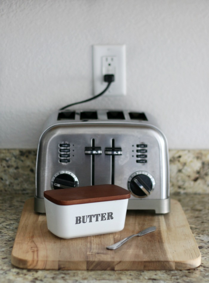 countertop styling with toaster on cutting board and butter dish