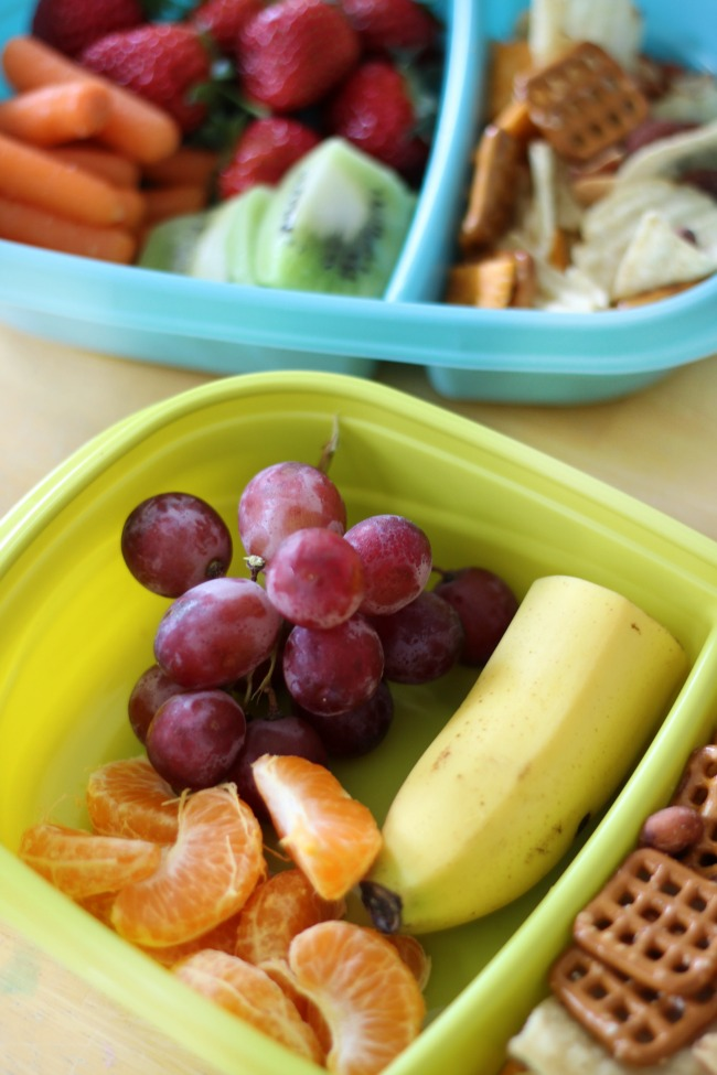 fresh fruit road trip snacks grapes, bananas, oranges and snack mix