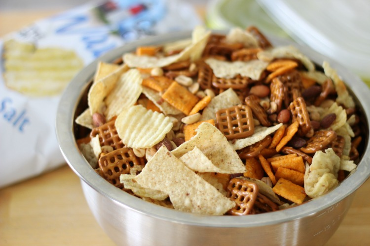 bowl filled with tortilla chips, potato chips, pretzels and cheese crackers