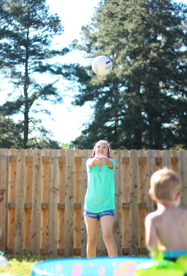 backyard activities for kids: girl playing volleyball