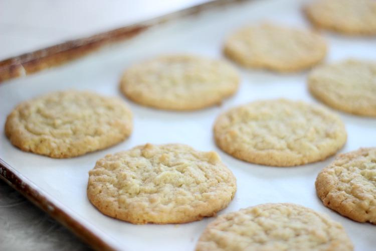 crispy coconut cookies on baking sheet