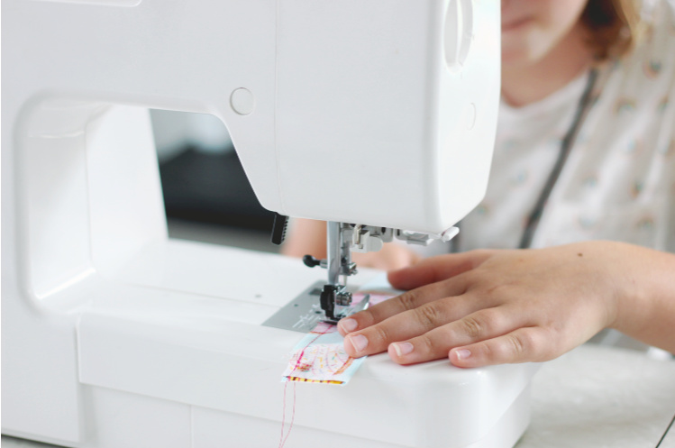 sewing machine, girl stitching a seam