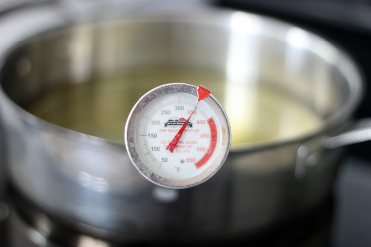 oil thermometer in pan of oil