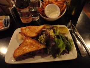 Freidman's pastrami sandwich and sweet potato fries