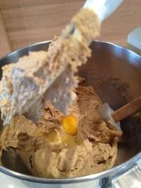 Adding eggs.