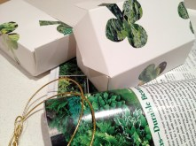 Decorating candy boxes with shamrocks from recycled magazines