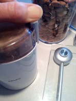 Grinding the almonds in the Krups mill