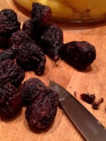 Cutting the last bit of stem off the dried figs