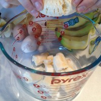 Breaking the bananas into the (bowl)