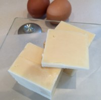 Weighing the cheese for a half portion