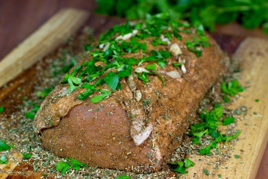 spice-rubbed meat on a wood cutting board