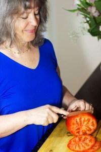 Barbara, of Gluten Free Homestead, slicing a tomato
