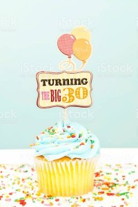 'Turning 30 ve birthday cupcake with. celeratory balloons