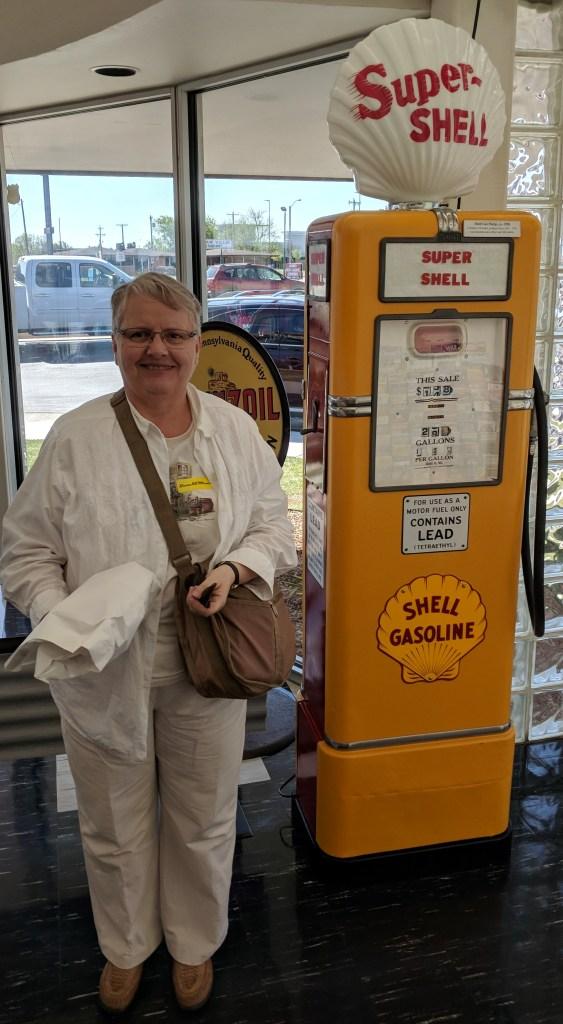 Anna beside old gas pump