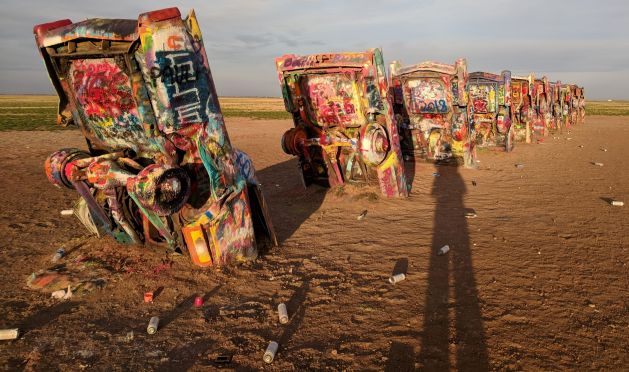 Cadillac Ranch showing Rattle Cans littering the ground