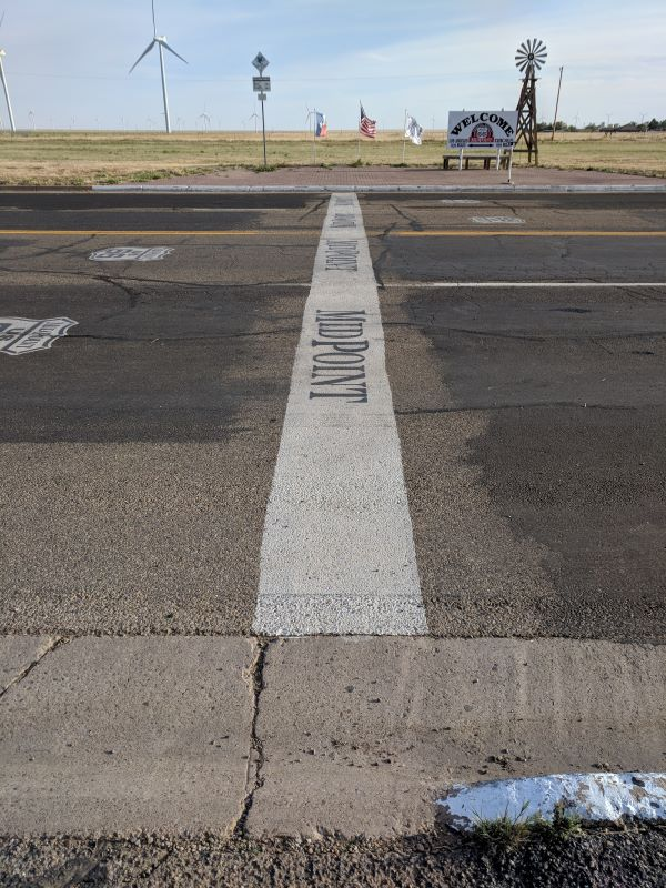 The Midpoint line painted on the road