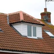 Pitch Roof Hip End Dormer - Low Maintenance Cement Fibre Board External Cladding. Window With Obscure Glass To Match Existing. Property In Braintree
