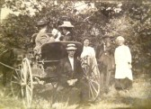 Mina and Meta Steadman in the buggy with th dog; Clarence Lester sitting in front; Amozelle Lester Morris standing next to buggy; unknown elderly couple (Steadmans?)
