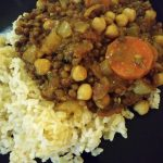 Lentil and chickpea stew with carrots over rice