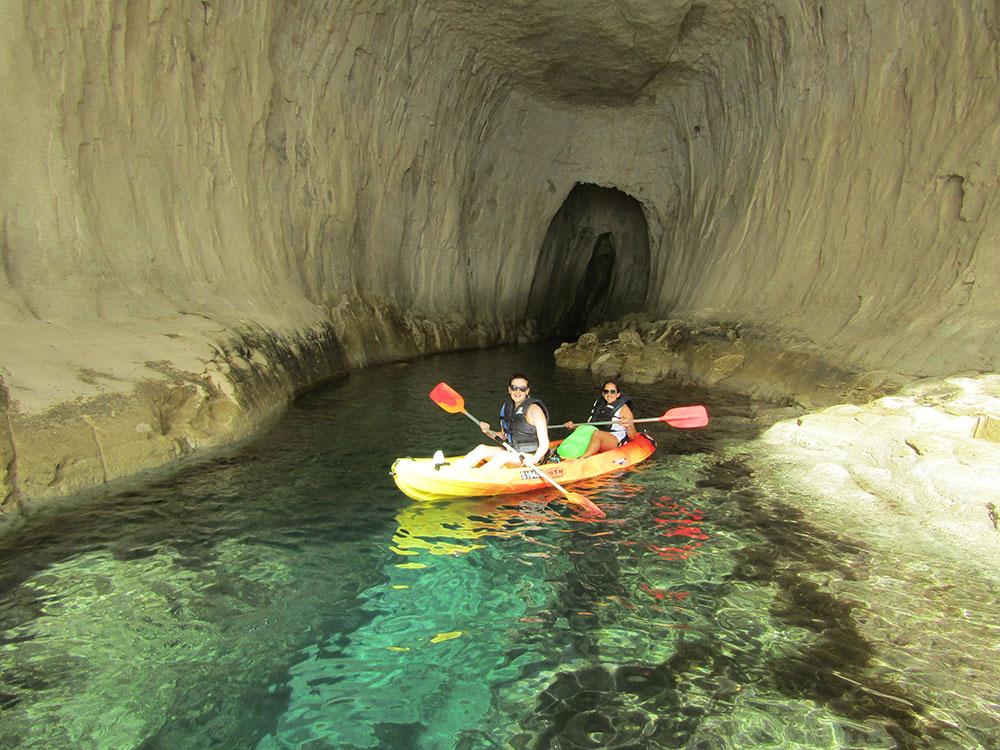 Inside Għar Marija with a rented kayak