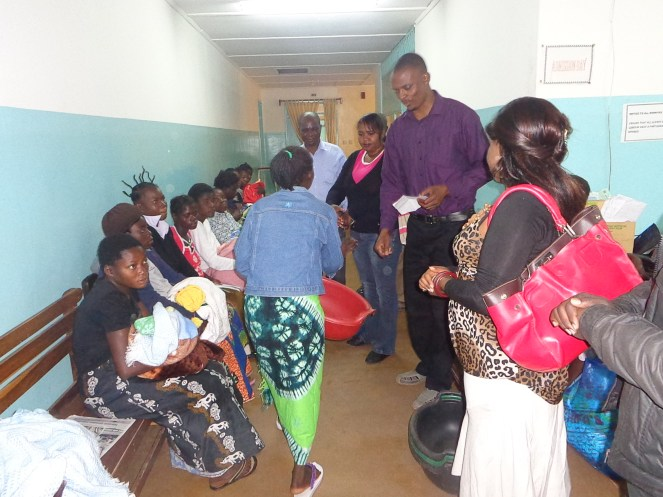 Offering technical support supervision to health workers while they were giving nutrition education to mothers with newly born babies during commemoration of World Breastfeeding Week 2012