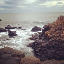 """So the Giant's Causeway is this shore where the rocks are pillar, hexagonal shapes. Volcanic eruptions more than sixty million years ago or something. OR as Rick Steves writes, """"It's as if the earth were offering God his choice of 37,000 six-sided cigarettes."""" Well played, Rick Steves. Well played."""