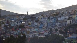 Quito suburbs with Virgin Mary Statue on the skyline