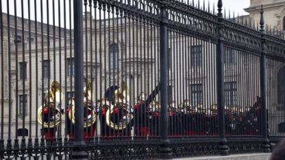 The band - behind Palace bars.