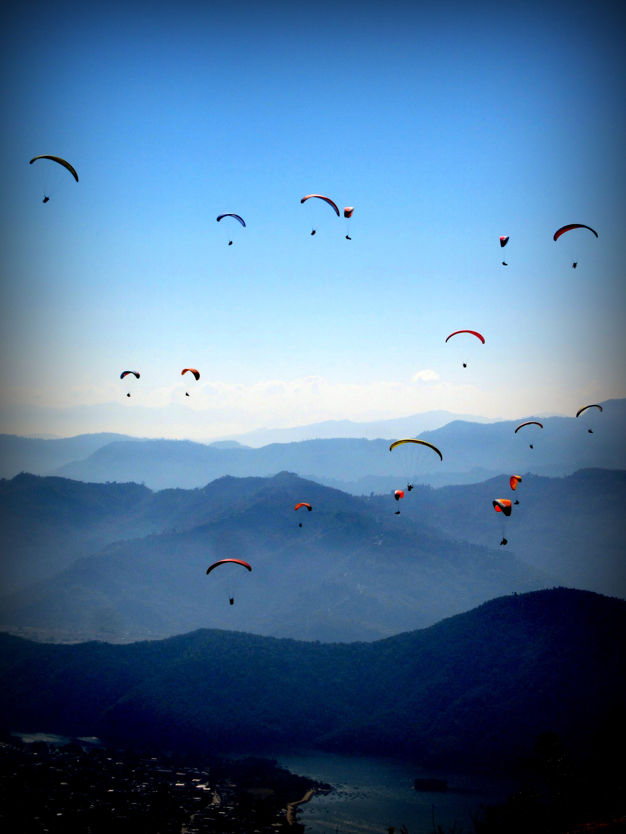 The sky in Pokhara is filled with paragliders-- Flying at the top of the world. Pokhara, Nepal
