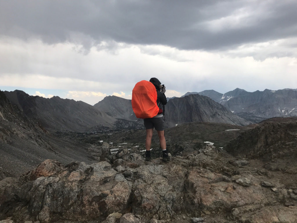 On the top of Pinchot Pass, I stand like a neon sentry