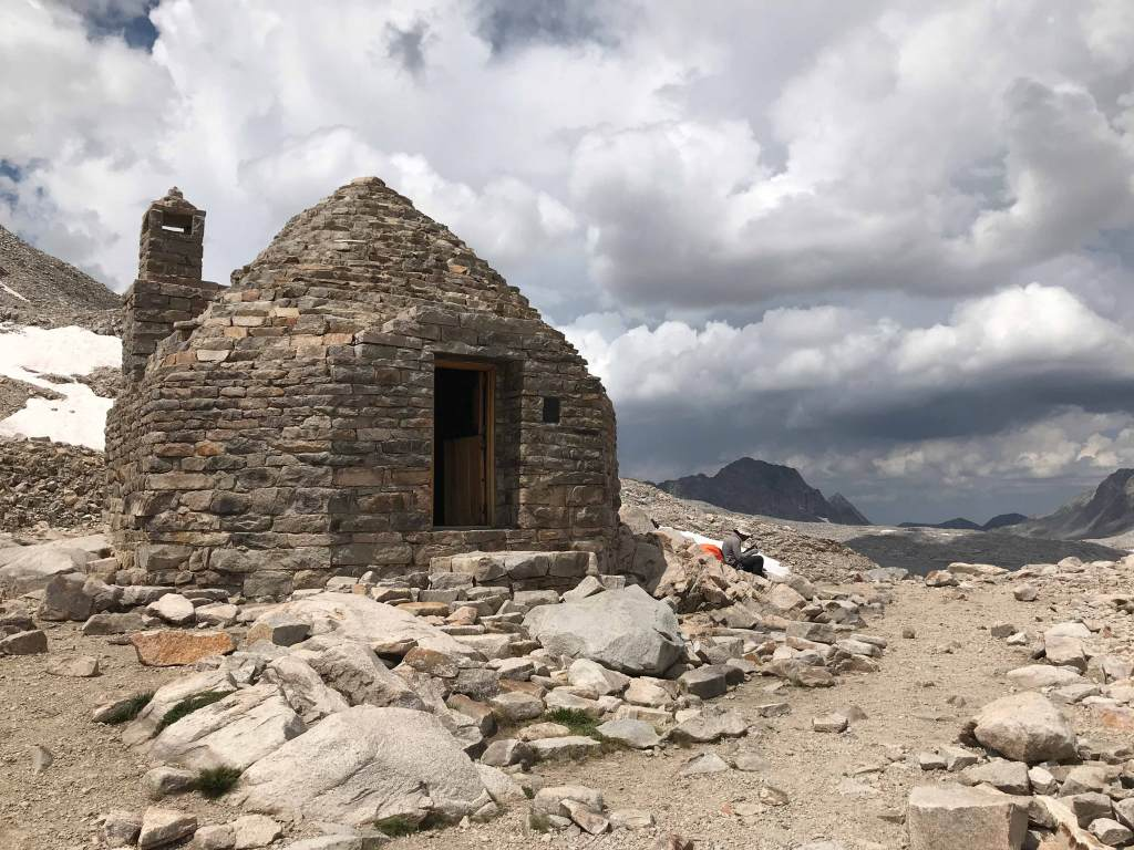 The Muir Hut stands atop Muir Pass and serves as a refuge for backpackers caught in storms that often hit the area.