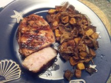 grilled pork chop with roasted butternut squash and caramelized onions