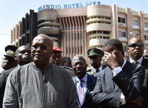 "Burkina Faso's President Roch Marc Christian Kabore (L) and Benin's President Thomas Boni Yayi (R) visit the Splendid hotel and the Capuccino cafe on January 18, 2016 in Ouagadougou, following a jihadist attack by Al-Qaeda in the Islamic Maghreb (AQIM) late on January 15. West African nations will ""fight back"" after a Burkina Faso hotel attack that left 29 dead and showed jihadist fighters expanding their reach in the region, Benin President Thomas Boni Yayi said on January 18, 2016. Friday's attack on a four-star hotel, which left at least 29 dead, half of them foreigners, came weeks after an attack on a luxury Mali hotel in Bamako claimed by Islamists that left 20 people dead. / AFP / ISSOUF SANOGOISSOUF SANOGO/AFP/Getty Images"